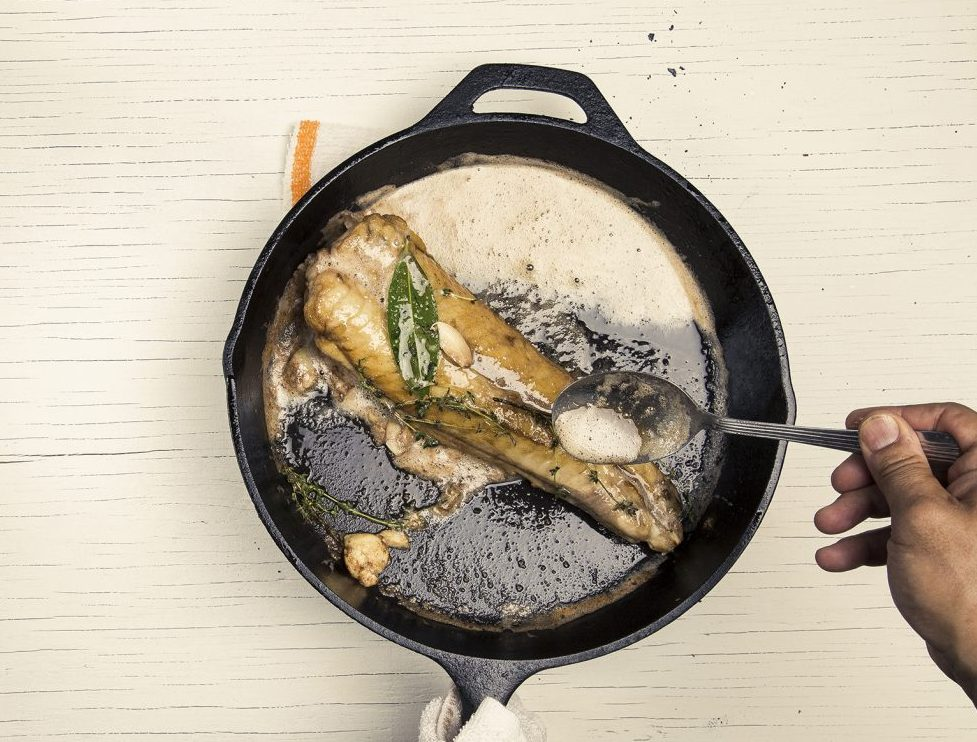 Aerial food photography, fish in skillet